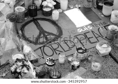TORONTO, CANADA - NOVEMBER 21, 2015: Candles and flowers at the Toronto memorial for the Paris terror attack. - stock photo