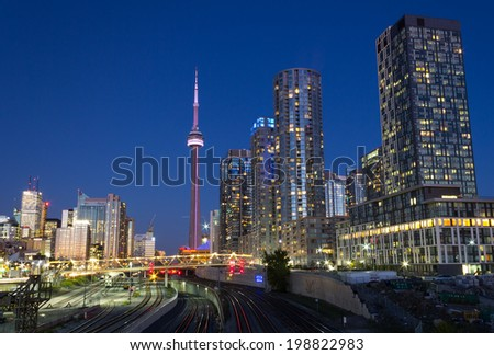 TORONTO, CANADA - OCTOBER 8, 2013: An urban scene from Toronto showing the CN Tower, Skyscrapers and Condos at night - stock photo