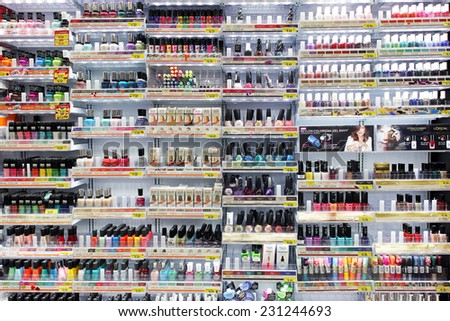 TORONTO, CANADA - OCTOBER 31, 2014: Variety of cosmetic products and nail colors on display in a department store. Nail care is one of the strongest categories of cosmetic products industry. - stock photo