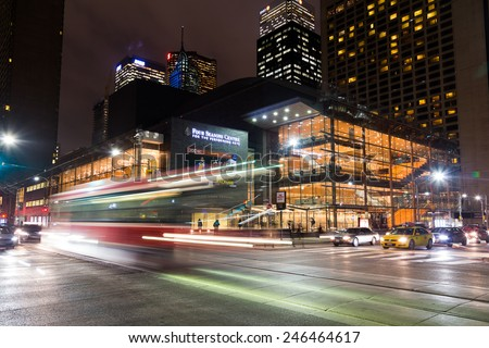 TORONTO, CANADA - 21ST JANUARY 2015: The outside of the Four Seasons Centre For The Performing Arts at night. Traffic and people can be seen. - stock photo