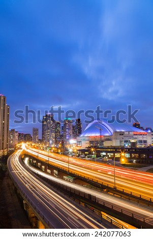 TORONTO, CANADA - 30TH DECEMBER 2014: A view of the Gardiner Expressway in Toronto at rush hour showing the trail of traffic - stock photo