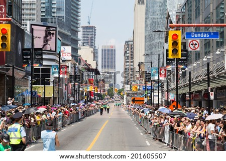 TORONTO, CANADA - 29TH JUNE 2014: View down Yonge Street for the World Pride Parade in Toronto showing large crowds - stock photo