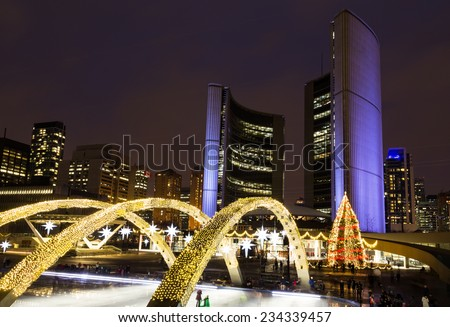 TORONTO, CANADA - 30TH NOVEMBER 2014: Toronto City Hall at night at Christmas, showing lights around the front of the building and the Christmas tree. - stock photo