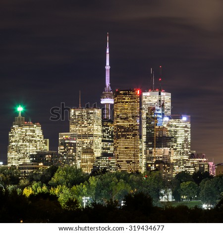 TORONTO, CANADA - 10TH OCTOBER 2014: Part of downtown Toronto at night showing buildings in downtown. - stock photo