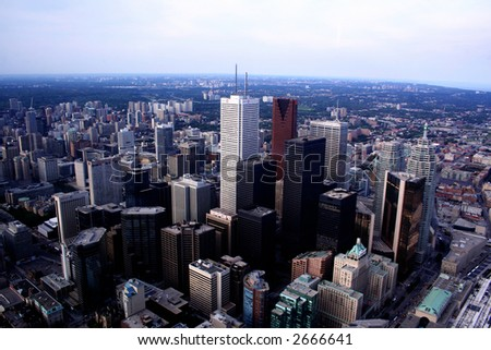 TORONTO CITY SKYLINE WITH CURVE OF EARTH AND TELL BUILDINGS AND SKYSCRAPERS - stock photo