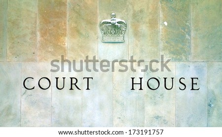 Toronto Court House sign carved in the exterior wall - stock photo