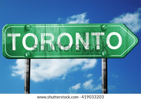 Toronto, 3D rendering, a vintage green direction sign - stock photo