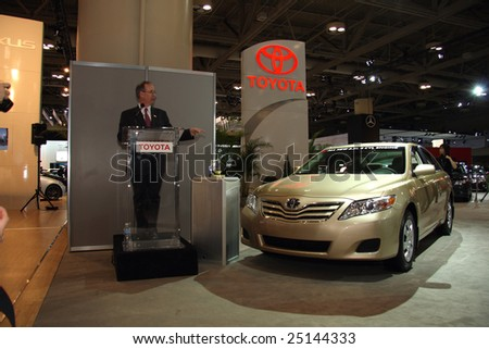 TORONTO, FEBRUARY 11: A Toyota representative speaks about the challenges ahead and Toyota's green technologies at the Canadian International AutoShow 2009 held on Feb. 11, 2009 in Toronto, Canada. - stock photo