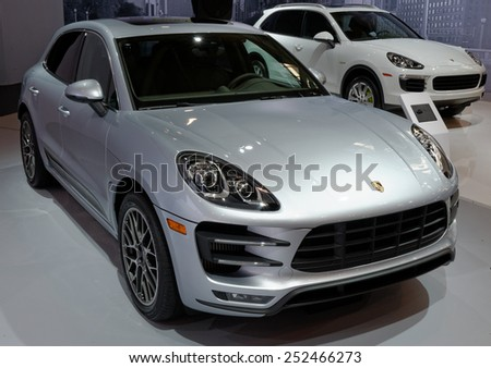 TORONTO-FEBRUARY 12: at the 2015 Canadian International Auto Show  Porsche Macan Turbo is the new class leader in the mid-size luxury SUV segment  on February 12, 2015 in Toronto  - stock photo