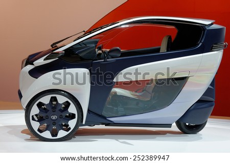 TORONTO-FEBRUARY 12: at the 2015 Canadian International Auto Show Toyota i-Road is the ultimate fuel-efficient and fun-to-drive small urban vehicle  on February 12, 2015 in Toronto  - stock photo