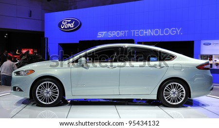TORONTO-FEBRUARY 16:Ford Fusion Hybrid  shown on display at the 2012 Canadian International Auto Show on February 16, 2012 in Toronto, Canada. - stock photo
