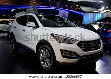 TORONTO-FEBRUARY 14:  Hyundai Santa Fe at the 2013 Canadian International Auto Show on February 14, 2013 in Toronto - stock photo