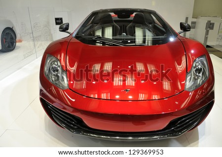 TORONTO-FEBRUARY 22: The McLaren 12C Spider on display during the 40th International Auto Show on February 22, 2013 in Toronto, Canada. - stock photo
