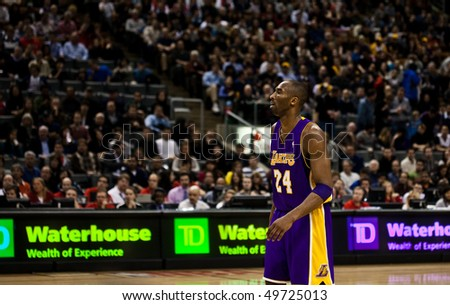 TORONTO - JANUARY 24: Kobe Bryant #24 participates in an NBA basketball game at the Air Canada Centre on January 24, 2010 in Toronto, Canada.  The Toronto Raptors beat the Los Angeles Lakers 106-105. - stock photo