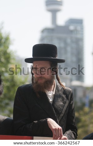 TORONTO-JULY 11:  A Jewish Rabbi during the Al-Quds day rally on July 11, 2015 in Toronto,Canada. - stock photo
