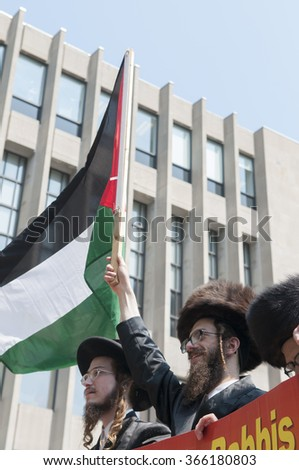 TORONTO-JULY 11: Israeli Rabbis waving Palestinian flag during the Al-Quds day rally on July 11, 2015 in Toronto,Canada. - stock photo