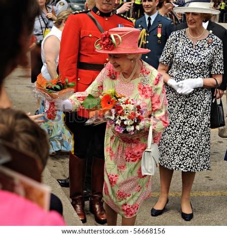 TORONTO-JULY 06: On the final day of her nine-day Canadian tour, Queen Elizabeth II bid farewell to the country at Queen's Park in Toronto on Tuesday morning, in Toronto July 06, 2010 - stock photo