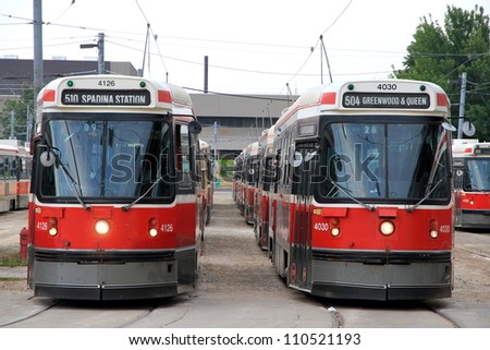 TORONTO - JULY 22: Streetcars at a city depot on July 22, 2012 in Toronto. The Toronto Transit Commission (TTC) current fleet includes 248 streetcars. - stock photo
