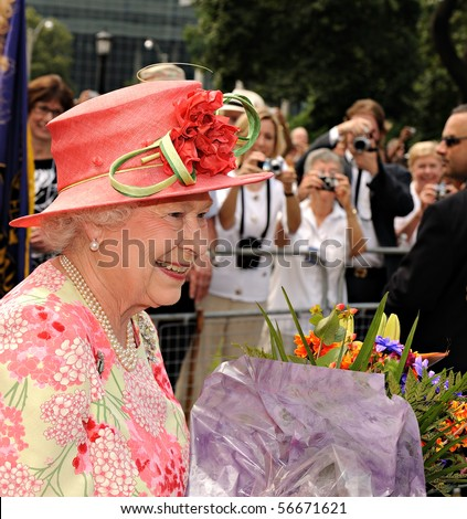 TORONTO-JULY 06: The Queen took a lengthy walkabout through crowds, who stood behind barriers in Toronto to catch a glimpse of Her Royal Highness in Toronto, July 06, 2010 - stock photo