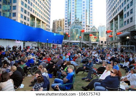 TORONTO - JUNE 13: A concert of the annual Luminato Festival on June 13, 2012 in Toronto. Luminato events take place in multiple indoor and outdoor locations throughout Toronto�s downtown core. - stock photo