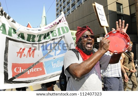 TORONTO-JUNE 25: A muslim man chanting slogans against capitalism during the G20 Protest on June 25, 2010 in Toronto, Canada. - stock photo