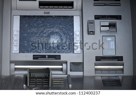 TORONTO-JUNE 28: A Vandalized ATM machine during  the G20 summit on June 28, 2010 in Toronto,Canada. - stock photo
