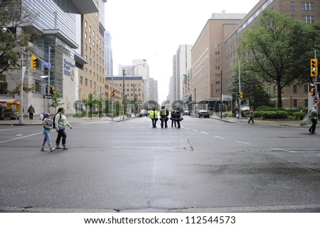 TORONTO-JUNE 26:  Empty downtown streets of Toronto  during the G20 Protest on June 26 2010 in Toronto, Canada. - stock photo