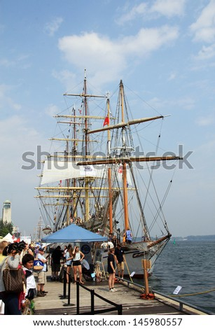 TORONTO - JUNE 22: People on the embankment at  RedPath Waterfront Festival  - tall ships - in June 22, 2013 Toronto, Canada - stock photo
