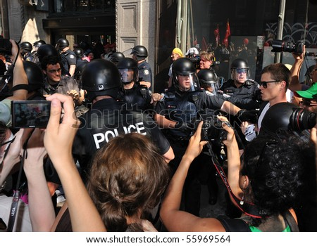 TORONTO-JUNE 25: Police and protesters clash at G20 Protest on June 25, 2010 in Toronto, Canada. - stock photo