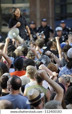 TORONTO-JUNE 28:   Protesters raising their hands as a mark of solidarity during a protest rally in front of the police headquarter after the G20 summit on June 28, 2010 in Toronto, Canada. - stock photo