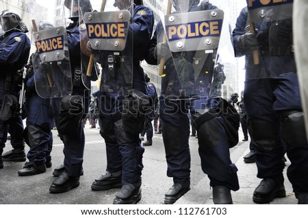 TORONTO-JUNE 26:   Riot police officers with their riot gears during the G20 Protest on June 26 2010 in Toronto, Canada. - stock photo