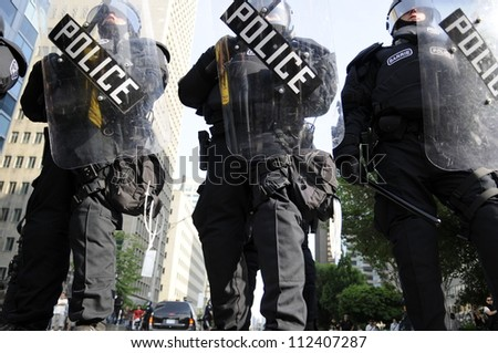 TORONTO-JUNE 25:  Riot police  taking control of every inch of Toronto  during the G20 Protest on June 25, 2010 in Toronto, Canada. - stock photo