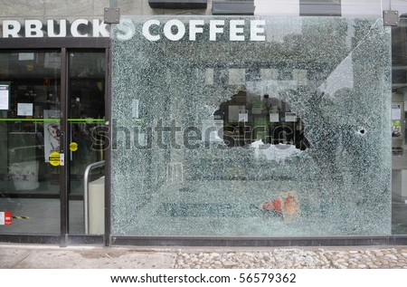 TORONTO-JUNE 26: StarBucks coffee shop window was smashed during G20 protests on June, 26 2010 in Toronto , Canada. - stock photo