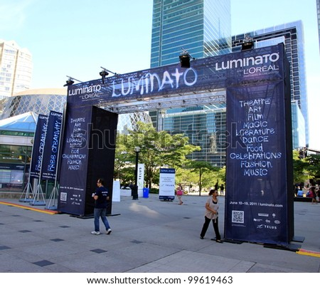 TORONTO - JUNE 19: The Luminato festival on June 19, 2011 in Toronto. Luminato - Toronto Festival of Arts and Creativity, is multi-disciplinary arts festival held annually each June in Toronto. - stock photo