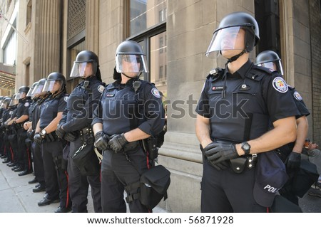 TORONTO-JUNE 25:  Toronto Police officers in riot gear line up  during the G20 Protest on June 25, 2010 in Toronto, Canada. - stock photo