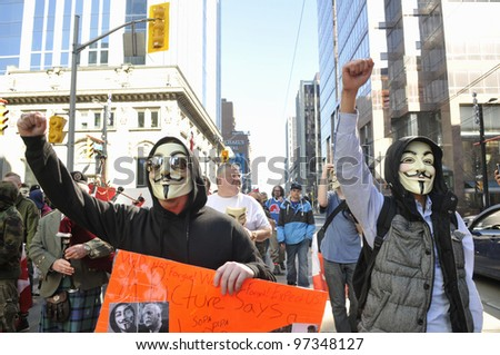 "TORONTO -MARCH 11: Occupy Toronto activists chanting slogans to protest against the ""robocalls scandal"" -a kind of election fraud from last year'Â?Â?s federal election on March 11 2012 in Toronto,Canada. - stock photo"
