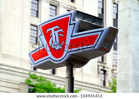 TORONTO - MAY 27: A TTC symbol outside a subway station on May 27, 2012 in Toronto. The TTC operates the third most heavily used urban mass transit system in North America. - stock photo