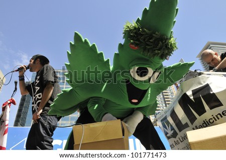 TORONTO - MAY 5: Live music and dance entertaining the crowd during the 14th annual Global Marijuana March on May 5  2012 in Toronto, Canada. - stock photo