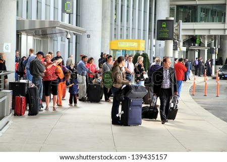 TORONTO - MAY 10: People at the Pearson Airport on May 10, 2013 in Toronto. In 2011, Toronto Pearson handled 33.4 million passengers and 428,477 aircraft movements. - stock photo