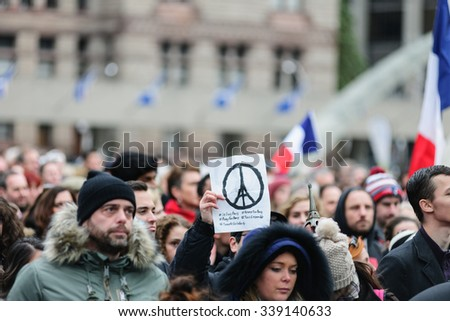 Toronto November 14, 2015 Crowds gather at Toronto's Nathan Phillips Square for a silent vigil this afternoon to honour those lost and injured in the terror attacks on Paris.  - stock photo