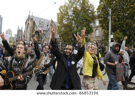 TORONTO - OCTOBER 17: Protestors clapping and chanting slogans  during the Occupy Toronto Movement on October 17, 2011 in Toronto, Canada. - stock photo