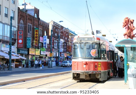 TORONTO, ON, February 9: Chinatown showing city transportation streetcar, the TTC is the largest public ground transportation in Canada,  on February, 9, 2012 in Toronto Ontario, Canada - stock photo