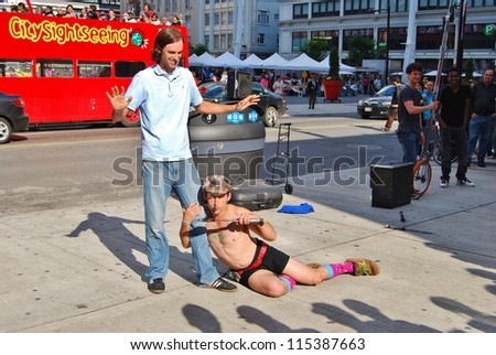TORONTO,ON - JUNE 07:Man Performing at Yonge-Dunda Square on June 07, 2010 in Toronto, Canada. Yonge- Dunda Square, a commercial public square, hosts events,and it is one of Toronto's main attraction. - stock photo