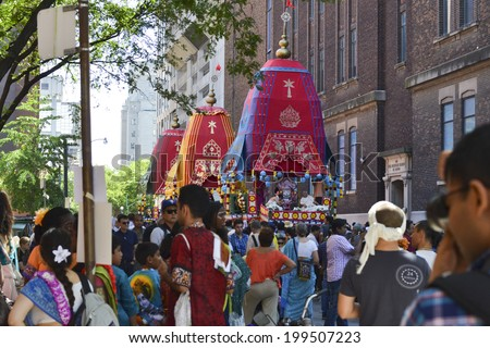 TORONTO, ONTARIO/CANADA - JULY 13: Devotees of Lord Krishna, decorated rath during celebration of 41st Annual Festival of India on July 13, 2013 in Toronto,Canada.  - stock photo