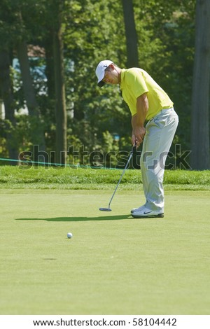 TORONTO, ONTARIO - JULY 21 : English golfer Paul Casey putts during a pro-am event at the RBC Canadian Open golf July 21, 2010 in Toronto, Ontario - stock photo