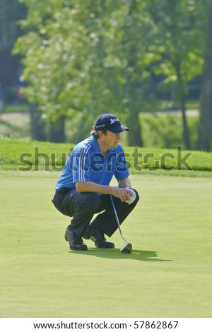 TORONTO, ONTARIO - JULY 21 : South African golfer Tim Clark lines up a putt during a pro-am event at the RBC Canadian Open golf on July 21, 2010 in Toronto, Ontario. - stock photo