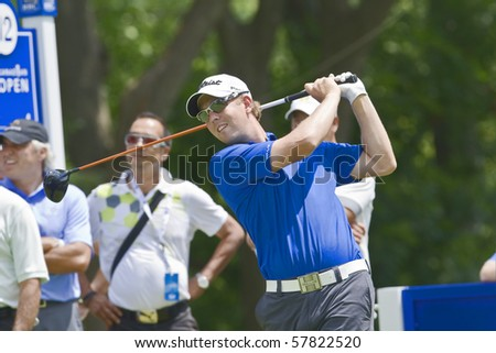 TORONTO, ONTARIO - JULY 21: U.S. golfer Bryce Molder follows his tee shot during a pro-am event at the RBC Canadian Open golf on July 21, 2010. - stock photo