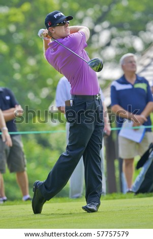 TORONTO, ONTARIO - JULY 21: U.S. golfer Hunter Mahan follows his tee shot during a pro-am event at the RBC Canadian Open golf on July 21, 2010. - stock photo