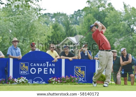TORONTO, ONTARIO - JULY 21: US golfer Chris DiMarco unleashes a drive during a pro-am event at the RBC Canadian Open golf, St. George's; Golf and Country Club on July 21, 2010 in Toronto, Ontario. - stock photo
