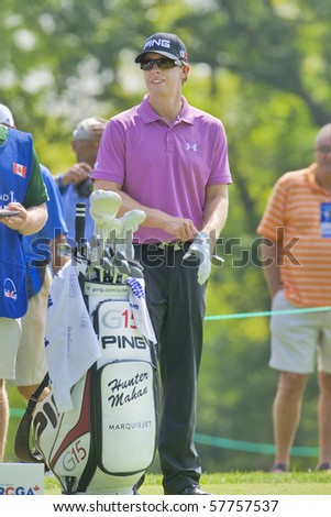 TORONTO, ONTARIO - JULY 21: US golfer Hunter Mahan prepares to tee off during a pro-am event at the RBC Canadian Open golf on July 21, 2010. - stock photo